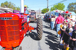 Wendell Newman, of Carson, rolls through town on a tractor during the Dayton Days parade Saturday.