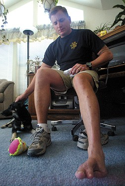 Marine Corps Staff Sgt. Bill Murwin talks about how he lost part of his foot when a grenade landed in the Humvee he was in while in Iraq. | photo by Brad Horn