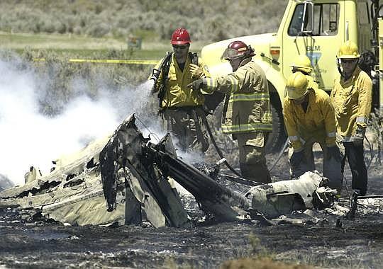 Cathleen Allison/Nevada AppealCrews extinguish burning debris from  a fatal plane crash near Eagle Valley West Golf Course.