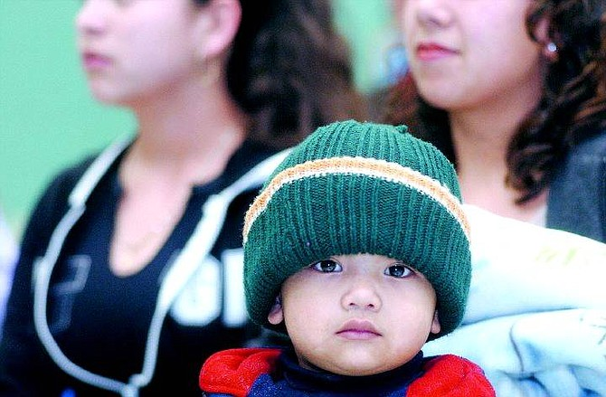Rick Gunn/Nevada Appeal Alexis Castillo, 2, listens to speakers during an information night for Hispanic parents at Mark Twain Elementary School on Wednesday evening. Nevada Hispanic Services is planning to host similar meetings every month.