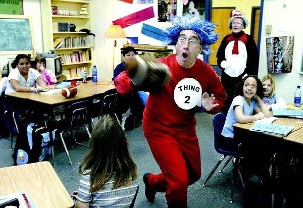 """Cathleen Allison/Nevada Appeal Bordewich Bray Elementary School Vice Principal Patrick Beckwith portrays """"Thing 2"""" in Dave McMasters class as part of the celebration of Dr. Suess' 100-th birthday on Wednesday.  Students were visited by the Cat in the Hat, Thing 1 and Thing 2 for reading month."""