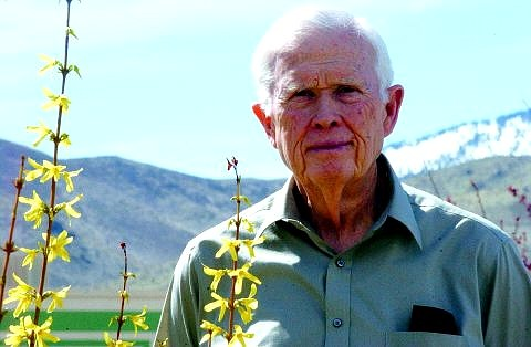 Rick Gunn/Nevada Appeal Bill McCord stands near blossoming flowers at the Nevada Appeal Friday.