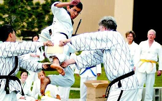 Edwin Seiler, 15, a second-degree black belt completes a flying kick in a Tai-Kwon-Do demonstration at the Multicultural Festival at Western Nevada Community College on Saturday.