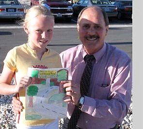 Becki West/For the Appeal Mariah West, daughter of Becki West of Minden, is shown with her winning poster and Mayor Ray Masayko after this year's Arbor Day tree planting at the Jack C. Davis Observatory at Western Nevada Community College.