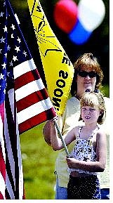 Cathleen Allison/Nevada Appeal Jody Ostrander, 7, and her mom Mary Jane, participate in the pro-America rally on the steps of the Legislature on Monday.