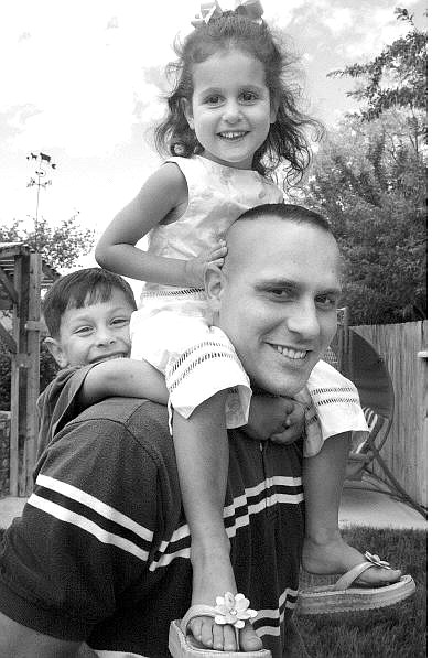 Cathleen Allison/Nevada Appeal Marine Staff Sgt. John Wyble plays with his family after returning home from his second tour of duty in Iraq.  John and his wife, Stephanie (not pictured), and their children Scott, 5, and Brianna, 3, are visiting Wyble's parent's Carson City home.