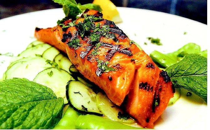 BRAD HORN/Nevada Appeal Mint-cured, wild spring creek salmon on a bed of cucumbers and snow peas.