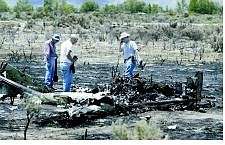 Government investigators sort through the wreckage Thursday of a small plane that crashed in East Carson City on  Wednesday.  Cathleen Allison Nevada Appeal