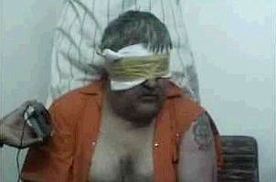 This image taken from an Islamic website, Tuesday June 15, 2004, shows a frame from a video of  blindfolded American hostage, Paul M. Johnson Jr., being held in Saudi Arabia. Johnson Jr., 49, was abducted Saturday, June 12, 2004.  Al-Arabiya television reported Friday, June 18, 2004, that Johnson Jr. has been beheaded.  (AP Photo)