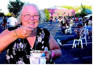 Charlene Ellis of Thousand Oaks, Calif., enjoys a bite from one of the restaurants in Saturday's Taste of Downtown, a fund-raiser for Advocates to End Domestic Violence. Ellis said she liked Daddy Dicks' spicy jambalaya.