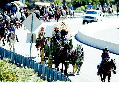 Brad Horn/Nevada Appeal The Highway 50 Association Wagon Train heads up Spooner Summit along Highway 50 West Saturday outside of Carson CIty. The train left Fuji Park at 7 a.m. and will arrive in Placerville, Calif., June 26.
