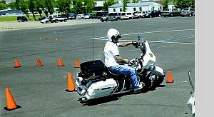 Carson City sheriff's motorcycle officers Sgt. Mike Cullen, left, and Deputy Bill Richards practice for the upcoming Fun Run on Friday and Police Motor Competition on Saturday at Mills Park. Deputy Wayne Wheeler, rear, is also competing.