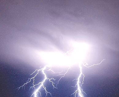 Nevada Appeal file photo Lightning strikes east of Silver Springs during a thunderstorm in this photo taken in 2002.