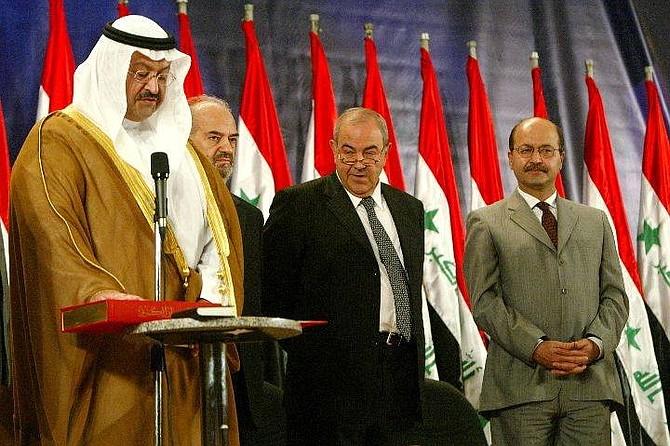 Iraqi President Ghazi Al-Yawer, left, is sworn in to office, as, from left, Vice President of Ibrahim Al-Jaafari, Prime Minister Iyad Allawi, and Deputy Prime Minister Barham Salih, look on in Baghdad, Iraq, Monday June 28, 2004. (AP Photo/David Guttenfelder)