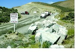Belinda Grant/Nevada Appeal Cinderlite trucks enter the company's Goni Road pit.