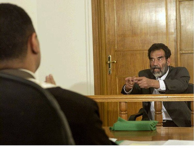 In this image cleared by the U.S. military former Iraqi President Saddam Hussein appears in a courtroom at Camp Victory, a former Saddam Palace, on the outskirts of Baghdad, Iraq Thursday, July 1, 2004. (AP Photo/Pool)