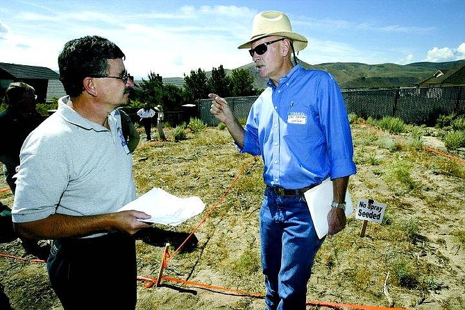 Cathleen Allison/Nevada Appeal University of Nevada, Reno Cooperative Extension plant and soil specialist Jay Davison, right, talks to Jerry Pieretti of the Carson City Fire Department Wednesday at test plots near Wellington Crescent where Davison has been studying the effects of a herbicide on cheatgrass.