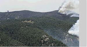 Associated Press Wildfires on Mount Graham near Safford, Ariz., burn near the Large Binocular Telescope, upper left, Monday.
