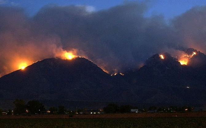 The Nuttall Complex fire continues to burn atop Mt. Graham Wednesday, July 7, 2004 in Safford, Ariz. (AP Photo/Matt York)