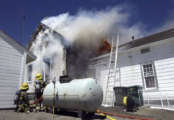 Cathleen Allison/Nevada Appeal The old school house in Silver City was destroyed by fire Wednesday.