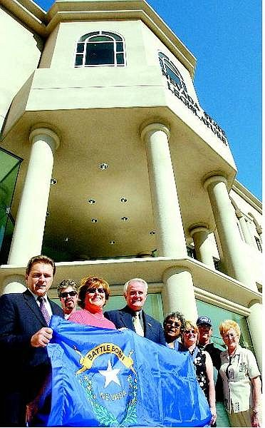 BRAD HORN/Nevada Appeal Art Angelo, from left, Stephen Lincoln, Pam Robinson, Rep. Jim Gibbons, R-Nev., Christina Slade, Karol Stetler, Albert Neudauer and his wife Dona pose in front of the Nevada State Legislature with the donated flag.
