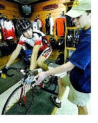 Bike Smith manager Mickey McDowell talks with employee Zachary  Walker about the proper wrist position when  measuring for a proper bike fit.    Cathleen Allison Nevada Appeal