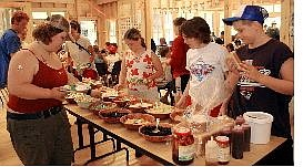 Associated Press Campers at Camp Merrowvista in Tuftonboro, N.H., fill lunch plates from the salad bar July 1. The nation's roughly 12,000 summer camps are under growing pressure to clean up their menus as parents and public health officials become increasingly concerned about childhood obesity.
