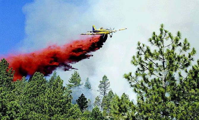 Cathleen Allison/Nevada Appeal A single-engine air tanker makes a drop in Kings Canyon as part of the effort to fight the Waterfall fire.