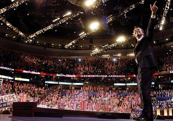Sen. John Edwards of North Carolina, gestures after speaking to delegates during the Democratic National Convention at the FleetCenter in Boston, Wednesday, July 28, 2004. (AP Photo/Robert F. Bukaty)