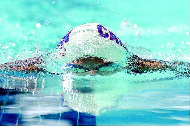 Alyson Redmond, 13, of the Carson Tigersharks swim club, competes in the 100 meter breaststroke during the Pacific Swimming Zone 4 Championships at the Carson Valley Aquatic Center in Minden, Nev., Friday, Aug. 6, 2004. AP Photo Brad Horn/Nevada Appeal