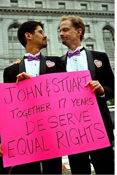 Gay couple Stuart Gaffney, left, and John Lewis protest in front of the California Supreme Court Thursday, Aug. 12, 2004, in San Francisco. San Francisco Mayor Gavin Newsom overstepped his authority when he issued more than 4,000 same-sex marriage licenses earlier this year, the California Supreme Court ruled Thursday. California's high court said Newsom did not have the authority to dole out 4,037 marriage licenses to gays and lesbians beginning Feb. 12, a move the justices said contradicted legislation and a voter-approved measure declaring marriage as a union between a man and woman.  Gaffney and Lewis were issued a same-sex marriage license six months ago in San Francisco. (AP Photo/Ben Margot)