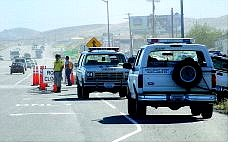 Lyon County Search and Rescue teams man the turnoff of Highway 50 east to  Virginia City.  The road was closed due to the Andrew fire.