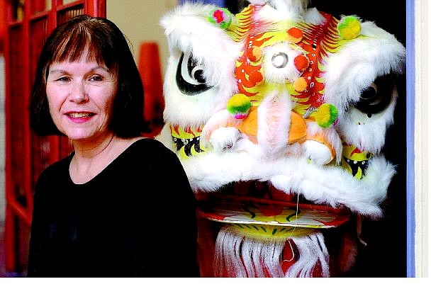 Rick Gunn/Nevada Appeal Dance instructor Carol Oliver sits next to a Chinese lion head in Carson City. She will begin dance classes in Dayton on Sept. 8.