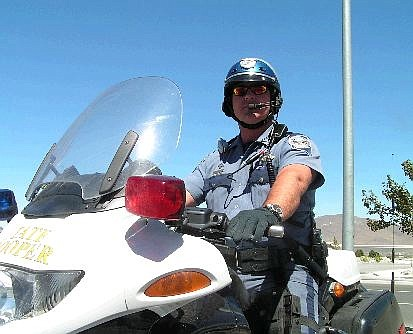 Geoff Dornan/Nevada Appeal Nevada Highway Patrol trooper John O'Rourke has been a motorcycle officer for three years. He suggests bikers and drivers take precautions to avoid accidents.