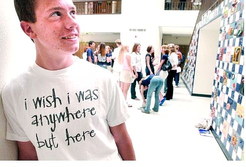 Daniel Scarbrough expresses his sentiments to a 'T' during the first day of school at Carson High School on Tuesday. At top, Carson High School students whir around Senator Square on Tuesday.     Rick Gunn Nevada Appeal