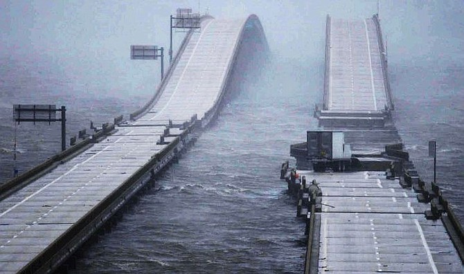 A quarter mile section of east-bound Interstate 10 bridge over Escambia Bay connecting Santa Rosa and Escambia is missing in Pensacola, Fla., Thursday. Sept. 16, 2004, following landfall of Hurricane Ivan. Part of the cement was pushed up on the side of the bridge and part of it was in the water. The west-bound section was damaged, but still standing.  (AP Photo/Fort Myers News-Press, Andrew West)