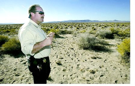 Cathleen Allison/Nevada Appeal Carson City Sheriff's Sgt. Bob White joined Churchill County Sheriff's Office officials off Trento Lane in Fallon after the badly decayed body of a woman was found Thursday.