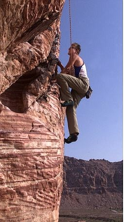 K.M. Cannon/Nevada Appeal Karl Horeis climbs on Cannibal Crag in Red Rock Canyon National Conservation Area near Las Vegas on Aug. 13, 2002. Horeis and a team of three other Nevada Appeal adventurers completed 10 challenges in 10 days. The quest was spurred by the Nevada Commission on Tourism's 2002 campaign promoting Nevada as an adventure destination.