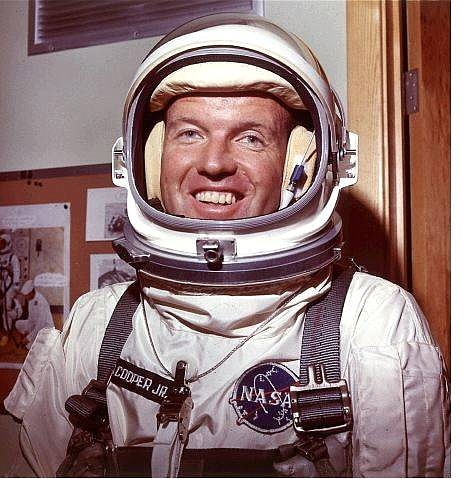 Astronaut Gordon Cooper is shown in his space suit, in this July 1965, file photo. Cooper, one of the original Mercury astronauts who were pioneers in human space exploration, has died. He was 77. Cooper died Monday, Oct. 4, 2004, at his home in Ventura, NASA officials said in a statement.  AP Photo/File