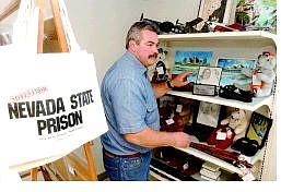 Rick Gunn/Nevada Appeal Nevada State Prison Hobby Store Manager Joseph Buchanan points out some of the products for sale during the grand opening of the NSP Hobby Craft Store on Friday morning.