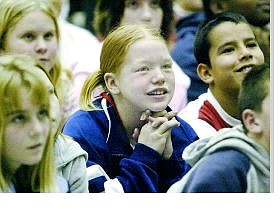 Ali Fleming, 11, waits anxiously for the DARE essay winner results during Monday morning's graduation ceremony at Fremont Elementary School. The group of more than 100 fifth-graders was the first class to graduate since the drug-resistance program was reinstated.