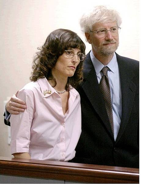 ** FILE ** Angel McClary Raich, left, and her husband attorney Rob Raich listen during a news conference in Oakland, Calif. in this June 28, 2004 file photo.  Raich, the mother of two, tried dozens of prescriptions, trying to ease the pain of her brain tumor and other illnesses before she tried marijuana.  The U.S. Supreme Court is scheduled to hear arguments Monday, Nov. 29, 2004 whether the support of her doctor - and California law - is enough to protect her from federal law.  (AP Photo/Noah Berger, File)