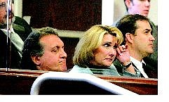 State Controller Kathy Augustine, center, wipes away a tear in the Senate Chambers during impeachment proceedings while her attorneys Dominic Gentile, left, and John Arrascada listen Saturday in Carson City.  Brad Horn Nevada Appeal