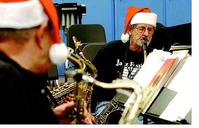 Rick Gunn/Nevada Appeal Bass sax player Gerry Wright goes over his sheet music Tuesday night at Eagle Valley Middle School.
