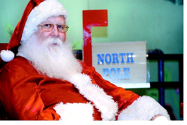 Rick Gunn/Nevada Appeal  Santa Claus recently set up a temporary shop at the Children's Museum of Northern Nevada to listen to children's Christmas wish lists.