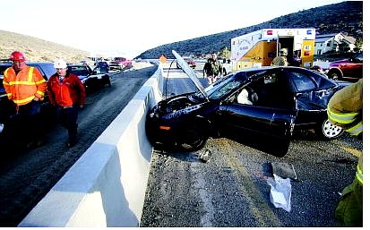 BRAD HORN/Nevada Appeal A Dodge Neon careened off the divider on U.S. 395 South in Carson City Thursday.