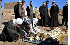 Associated Press Relatives of a policeman killed in an insurgent attack grieve during his funeral in Tikrit, Iraq, Tuesday. Nineteen policemen died when gunmen attacked the station Tuesday.