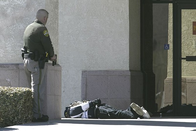 Cathleen Allison/Nevada AppealA man with a suspected bomb is held at bay by a Carson City Sheriff's Deputy.