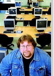 Western Nevada Community College computer instructor Michael Long stands in the computer lab where a host of Microsoft software will be installed and can be downloaded by computer students free of charge. The software was attained through the Microsoft Distribution Network Academy Alliance.  Rick Gunn/Nevada Appeal