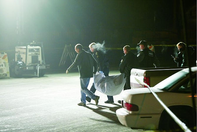 Photo by Josh Miller/Sierra SunTruckee police carry the body of a woman found in a parking lot in Tahoe Donner on Monday.